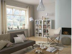 peinture salon : couleur blanc casse coussins pouf laine