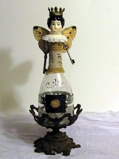Doll My first assemblage bottle doll from found objects. Diy Christmas Fireplace, Steampunk Dolls, Found Object Art, Junk Art, Altered Bottles, Vintage Dolls, Antique Dolls, Old Dolls, Assemblage Art