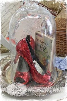 Perfect ruby slippers - Wizard of Oz centerpieces! I love the bell jar. Cloche Decor, The Bell Jar, Bell Jars, Ruby Slippers, Yellow Brick Road, Library Displays, Over The Rainbow, Glass Domes, The Wiz