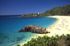 """Waimea Bay - great for swimming, It's like a giant pool. I've been too chicken to jump off """"da big rock"""" but maybe one day"""