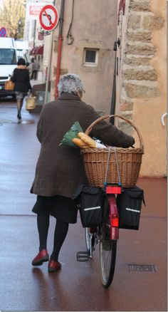 Everyone has a market basket and a baguette in France