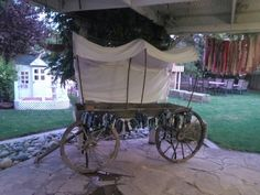 Covered Wagon table for a cowboy or western party. Total cost approximately $25. I used this as a,dessert/cake table.