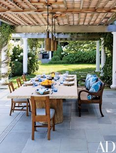 Lighting idea for my pergola. pendant lights from Robert Altman are suspended above the space's Juan Montoya–designed table and John Hutton for Sutherland side chairs Outdoor Furniture Sets, Decor, Outdoor Decor, Home, Outdoor Dining Area, Patio Table, Outdoor Dining, Contemporary Outdoor, Patio Dining