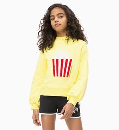 this sweatshirt has a bold terry popcorn applique on the chest and gathered bell sleeves for a girly silhouette. cut from super soft cotton, pair with this season's denim for a cute spring look. Kids Girls Tops, Dubai Fashion, Spring Looks, Printed Sweatshirts, Girls Jeans, Calvin Klein Jeans, Japanese Fashion, Kids Wear, Kids Outfits