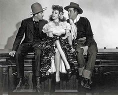 """Henry Fonda as Wyatt Earp and Victor Mature as Doc Holliday gaze admiringly at saloon gal, Chihuahua, played by the lovely Linda Darnell in """"My Darling Clementine."""""""