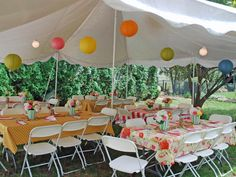 Even if you typically don't have an outdoor structure, events are a wonderful excuse to warm up your yard for guests. Paper lanterns are inexpensive and colorful and come in a rainbow of colors and a range of sizes. Check it the possibilities: http://www.partylights.com/Lanterns