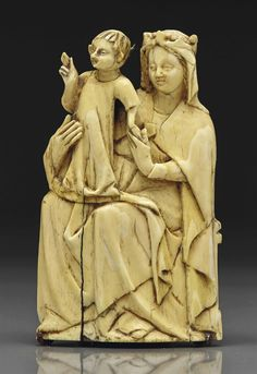 A CARVED IVORY GROUP OF THE VIRGIN AND CHILD, ITALIAN, SECOND HALF 14TH CENTURY