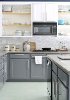 inspiring makeover: painted cabinets in gray & white with new glass tile backsplash