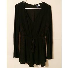 Black long sleeve boutique romper NEVER WORN! Size medium, long sleeve romper, ties around the waist, cute printed flower design, comfortable and perfect for spring/summer! Dress up with a pair of wedges or dress down with sandals! Purchased at Francesca's Francesca's Collections Pants Jumpsuits & Rompers