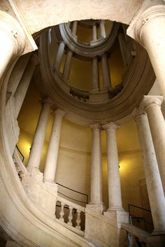 Palazzo Barberini Staircase - Rome,Italy.  Spiral stone with large columns.