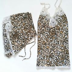 """BOGO VS Cheetah Satin Cami & Tap Short Sleep Set BOGO 50% SALE!  Roar! Soft silky satin gets a sexy twist with this pajama set! Cami has adjustable straps. V neckline finished with beautiful white lace. Shorts have drawstring elastic waist with lace trim at the sides. Approx. 2"""" Inseam.  Hardly worn. Like new. Last image shows fit on model wearing a different color. Set for sale is cheetah print with white lace. Victoria's Secret Intimates & Sleepwear Pajamas"""