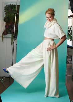 Houghton Persephone cowl neck crop top with cuffed short sleeves in ivory cashmere, Calliope high waisted wide leg cashmere trousers with inverted pleats