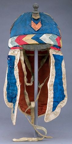 Indian helmet, 19th century, Sikkim culture, silk, brass, silver, H. including nape defense 18 1/2 in. (47 cm); H. excluding nape defense 6 1/2 in. (16.5 cm); W. 8 in. (20.3 cm); D. 8 1/2 in. (21.6 cm); Wt. 14.2 oz. (402.6 g), Bequest of George C. Stone, 1935, Met Museum. Sikkim is a small state in northwest India, bordered by Bhutan, Tibet and Nepal.