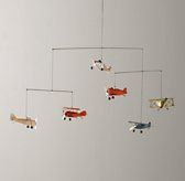 I want this mobile!!  Haven't seen another one I like as much.  Vintage Airplane Mobile - Restoration Hardware - $54