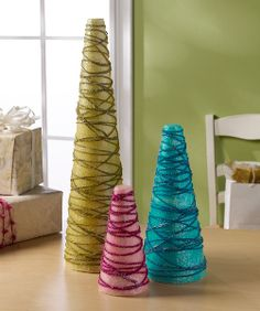 Tissue Paper and Yarn Tabletop Trees are easy holiday centerpieces for kids to make!