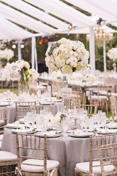 Gorgeous white orchid and cream colored rose wedding reception centerpiece; Via White Lilac Inc