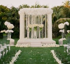 is literally the alter of your dreams. With a lot of strung flowers you can make this look happen.