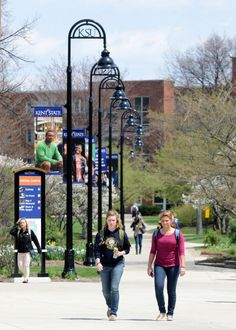 Kent State students walk on the esplanade in the spring.