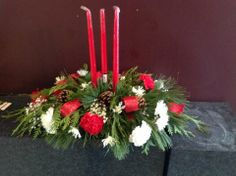Three candle oblong festive arrangement. Great for the holiday feast.