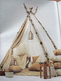 Indoor tent made of birch branches.