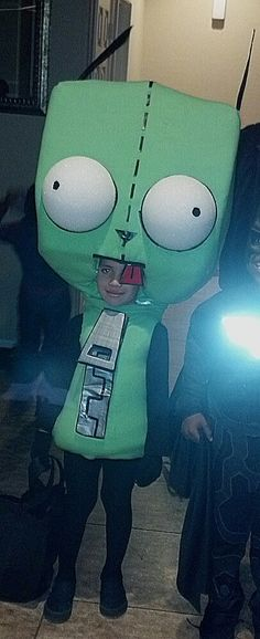"Gir Costume This costume is based on a character from the cartoon show ""Invader Zim."" The characters name is ""Gir."" It consists of hand sewn fleece, cotton batting, aluminum, wood, plastic, styrofoam duct tape and electrical tape. Most of the materials were found around the house."
