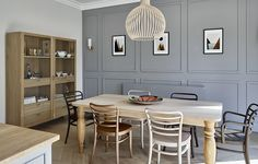 Dining area for the Surbiton Kitchen design - grey wall panels, oak farmhouse style table with contemporary dining chairs in different finishes, including copper, brown and cream. Light Grey Kitchens, Brown Kitchens, Oak Dining Table, Dining Area, Dining Room, Tall Storage Cupboard, Shaker Style Kitchens, Fitted Kitchens, Solid Oak Table