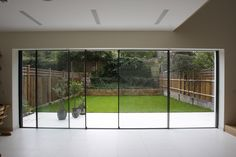 Bi parting minimal windows used as modern patio doors in London by IQ Glass.
