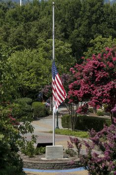The American flag flies at half mast in Coolidge Park after Tennessee Gov. Bill Haslam ordered it lowered in honor of victims of the July, 16 shootings on Saturday, July 18, 2015, in Chattanooga, Tenn. U.S. Navy Petty Officer Randall Smith died Saturday from wounds sustained when gunman Mohammad Youssef Abdulazeez shot and killed four U.S. Marines and wounded two others and a Chattanooga police officer. Photo by Doug Strickland /Times Free Press