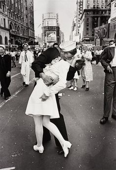 One of the most iconic photos in history taken on Victory over Japan Day, the Alfred Eisenstaedt Kissing on VJ Day in Times Square Wall Art is perfect for adding a touch of history to your wall. The picture shows a sailor kissing a nurse in Times Square.