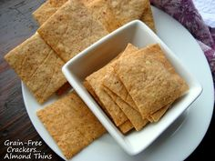 grain-free almond crackers...made these and the whole family loved them!!  Roll out and cut on parchment and then transfer crackers and all to cookie sheet to bake.