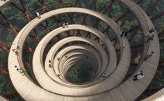 Architecture studio EFFEKT has released plans for a 600-metre-long treetop walkway connected to a spiralling observation tower with 360-degree views over the forest canopy of Haslev, Denmark