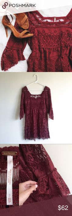 {SALE} •Free People Burgundy Lace Dress• Burgundy/Maroon Lace Dress.   →Size: XS →Worn twice, still in good condition.  →A slip is attached underneath the dress, can be unsnapped to remove.  →Length (shoulder to hem): 31 inches  →Bell Sleeves  →No trades(comments will politely be ignored). →15% off 2+ items  Free People Dresses