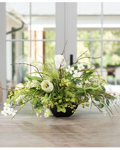 """{$tab:description} Impressive decorating is easy The crisp whites and greens of spring blooms bring a burst of permanent freshness into your home or office. White tulips, lilacs, dogwood, with green berries and viburnum, coalesce beautifully in a 6.5"""" square, black resin planter. A low profile silk flower centerpiece designed with fresh, monochromatic appeal, for your table, and year-round enjoyment.{$tab:DETAILS} 16"""" Height x 26"""" Width Black Resin Planter - 3.25""""H x 6.5..."""