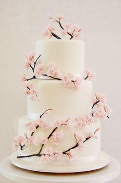 Three-tier classic cherry blossom wedding cake, white fondant. 2013.