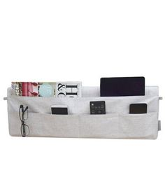Instead of letting clutter build up on the bedside table, slip magazines, tablets, and more into this large bedside pocket. Attached cable loops keep cords from tangling.