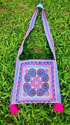 A personal favorite from my Etsy shop https://www.etsy.com/sg-en/listing/248590295/on-sale-hmong-embroidery-hilltribe
