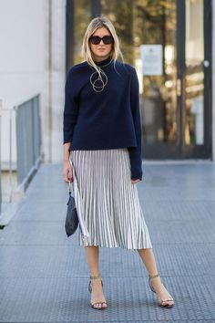 thanksgiving holiday outfit ideas - sweater, pleated midi skirt but booties because NY in cold.