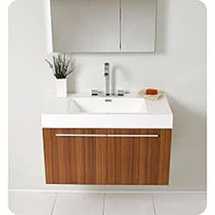 @Overstock - A teak finish highlights this contemporary bathroom vanity and medicine cabinet. This vanity features a Fresca Sesia faucet and chrome hardware.http://www.overstock.com/Home-Garden/Fresca-Vista-Teak-Bathroom-Vanity-and-Medicine-Cabinet/5522836/product.html?CID=214117 $899.00