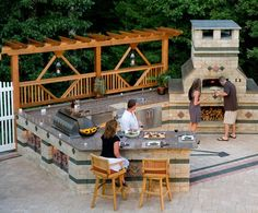 Outdoor Living with Pool Deck and kitchen featuring Brussels Block paver