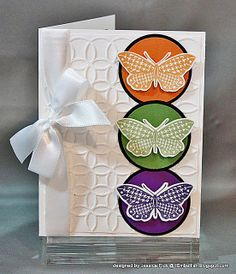 butterflies, circles, and embossing card