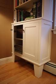 Built-in bookcase over baseboard heat.  Idea for putting cabinets where heater unit is.