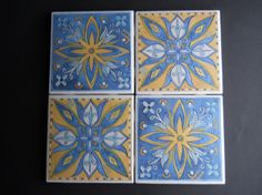 These wonderful handmade coasters are perfect for you, your friends & family, and for gift giving. This listing is for a set of four (4) very pretty and cool Spanish / Mexican style ceramic tile coasters in blue and yellow.  Each coaster measures 4.25x 4.25. Each coaster is assembled with ceramic tile, paper, a double layer of adhesive and a double layer of sealant, creating a water resistant surface for your glasses. Foam rubber squares back the corners of the coasters to protect yo...