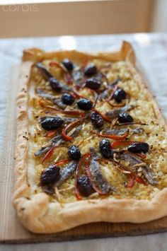 Pissaladiere (Onion and anchovy tart)  http://www.frenchentree.com/france-food-cuisine/displayarticle.asp?id=48759