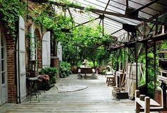 French Country House. I think I could live in this space, forever and ever. Wiiiiiiide verandah with cool green dappled light.