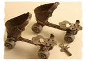 A pair of roller skates complete with the key