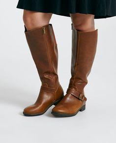 """<p>These basic riding boots feature a vegan leather upper with elastic detail, a buckle at the ankle, stylized stitching, a faux side zipper, and a comfy fit.</p>  <ul> <li>16"""" Shaft</li> <li>18.5"""" Calf Circumference</li> <li>1.25"""" Heel</li> <li>Zip Closure</li> <li>Lightly Padded Footbed</li> <li>Textured Sole</li> <li>Man Made Materials / Metal</li> <li>Imported</li> </ul>"""