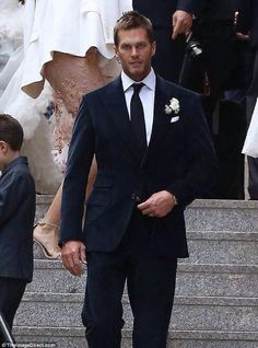 2a3d22b9a0426 Patriots star  Quarterback Tom Brady looked handsome in a blue velvet suit
