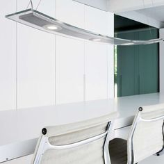 Gleaming with LED brilliance, in transparent and acid glass, Altena's pendant lights describe a gentle shining arc that's slim, stylish and sparing subtle. #Altena by #Lirio