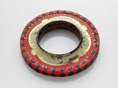 Bracelet | Harriete Estel Berman.  Preprinted steel from recycled tin containers, plastic core.
