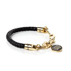 """ONYX: Black weaved leather bracelet. Gold electroplated chain link & charm featuring """"Chaz Ortiz"""" & Rastaclat debossed emblems. 100% Genuine Leather. 100% Sterling Silver Metal. $39.99"""